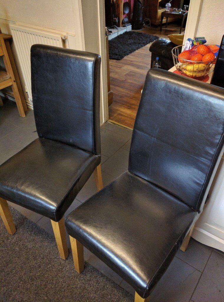 2 leather chairs with pine legs