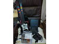 Playstation 2 with 2x guitars and lots of games