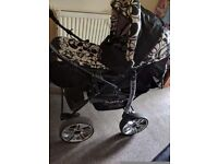 3 in 1 pram black and white comes with car seat and all accessories