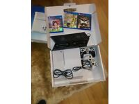 PS4 + 2 controllers, dock station and 3 games