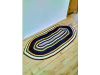 Large handwoven braided multicolor oval rug