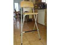 Tall IKEA table with 3 chairs, ideal as a kitchen table