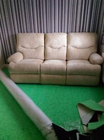 Three seater sofa and matching arm chair