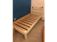 Single wooden bed.
