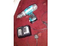Makita cordless with battery and charger