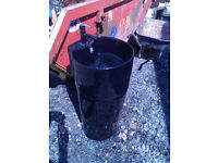 Black ceramic free standing bathroom basin and support