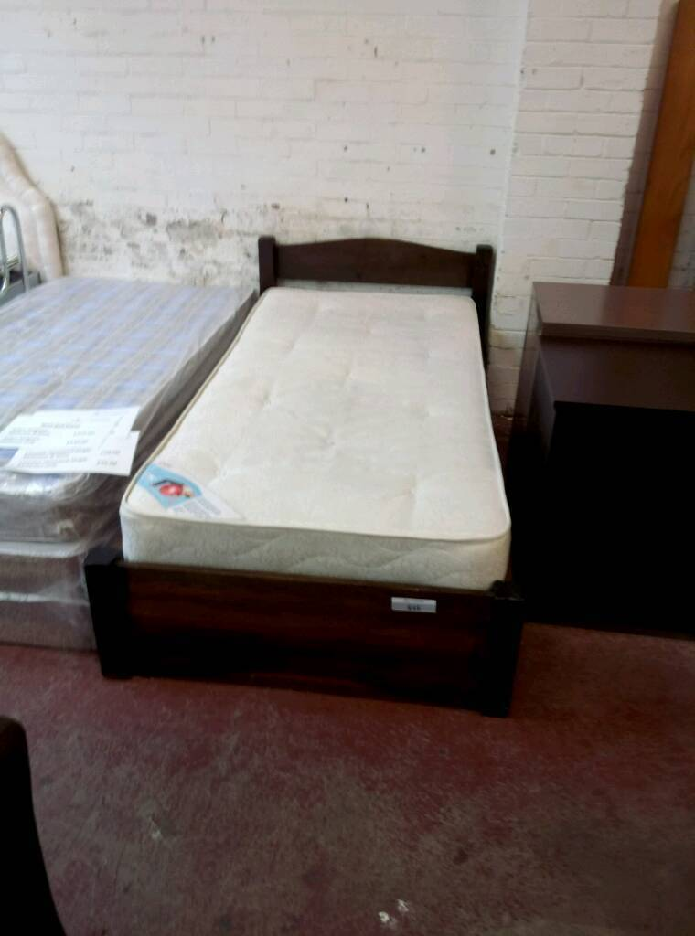 Wooden framed single bed and mattress