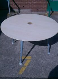 Round Maple effect office meeting table 1200mm with hole in centre on 4 legs