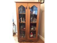 Solid wood display cabinet, contents not included, for sale.