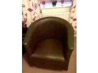 brown faux leather tub chair with oak color feet