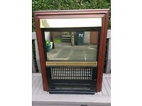Electric fire and surround. Mahogany surround, 3 bar fire 2kw. Perfect working order.