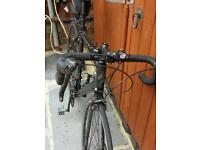 Specialized Allez mens all black road bike with accessories