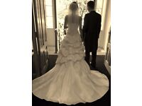Lovely ivory taffeta strapless wedding dress with detailed back lace up fastening, size 10 as new.