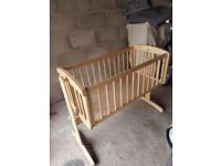 A babies wooden swinging crib.