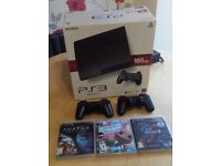PS3 160GB boxed with 2 Dualshock 3 controllers