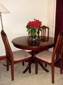 Mahogany round dining table with pedestal legs