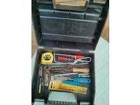 A 2 compartment toolbox with tools