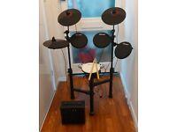 Carlsbro CSD130 8-Piece Electronic Drum Kit Plus A Amplifier Speaker.