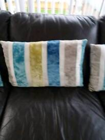 Four striped cushions
