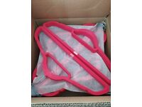 Brand new box of 50 slim pink coathangers