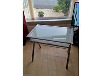 Solid table with pull out drawer