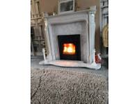 Multi burning inset stove with fire surround