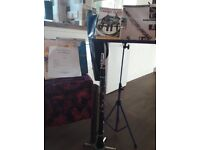 Clarinet with case, clarinet stand, music stand and selection of sheet music