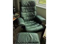 Swivel chair and matching footstool in dark green leather with polished wood legs.