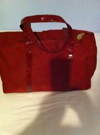 Red Este Lauder overnight bag