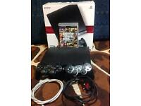 Sony PS3 with 2 controllers and 1 game