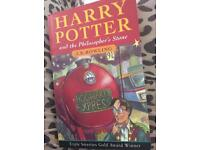 Harry Potter And The Philosopher's Stone; J.K Rowling official soft back copy.