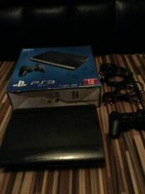 PlayStation 3 in the box good condition 1 controller drums and guitar 3x microphones