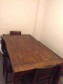 Great solid heavy wood dining table with four Chairs and bench in good used condition.