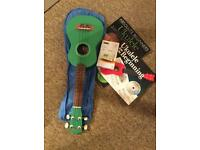 Ukulele, case, tuner and music books