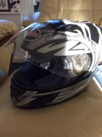 Motor cycle helmet. Used only a few times. Never been in an accident. Size small (50)
