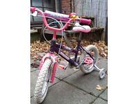Pink and purple little girls kids bicycle with stabilisers