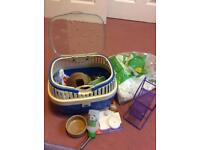 Small pet carrier complete with all you need for pet. Just need the cage!
