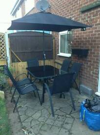 Garden table chairs and shade
