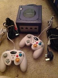 Purple Nintendo GameCube 2 controllers