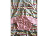Newborn pink hand knitted cardigan