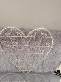 Decorative heart to hang photos or memos holds 19