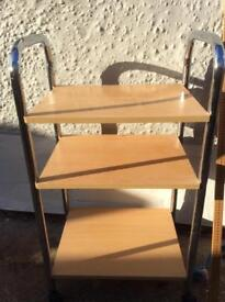 Small pine effect table on wheels