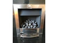 Gas Fire with black stone surroundings and Wooden fireplace