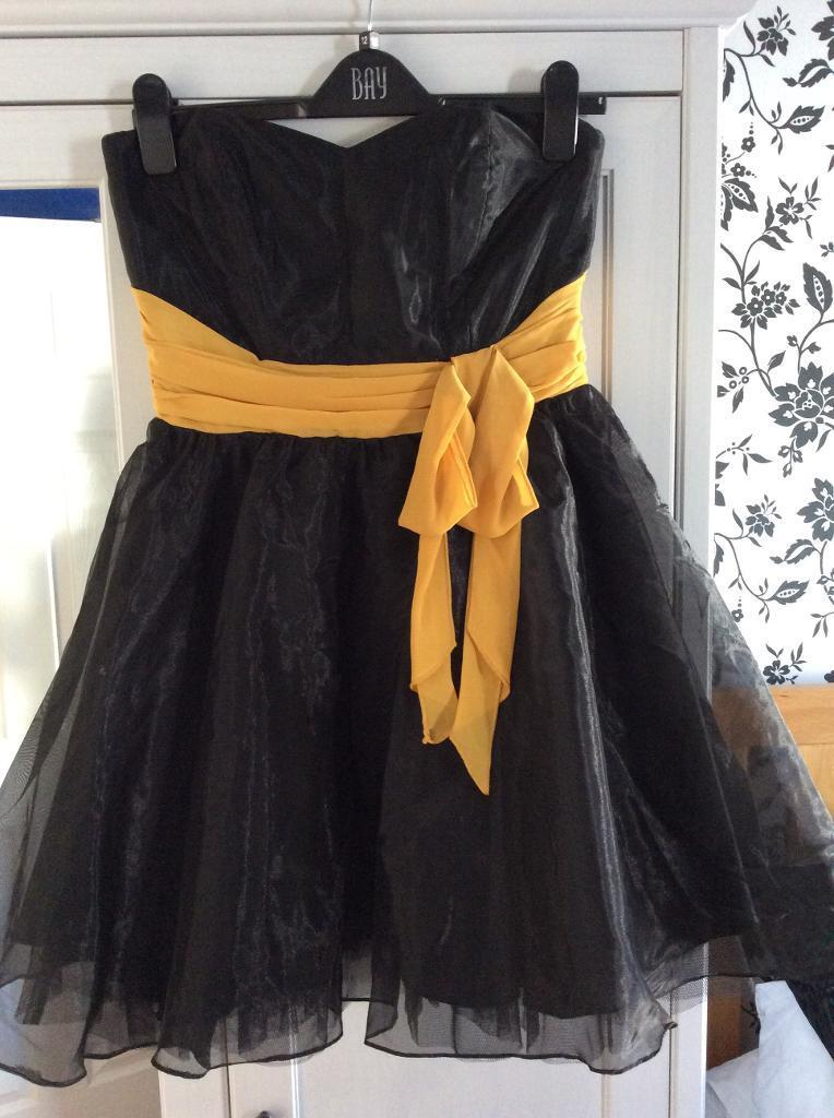 Black Lipsy Prom Dress Size 10 12in Grangetown, CardiffGumtree - Black lipsy prom dress size 10 12. With yellow belt/ribbon. Perfect for the party season! Originally size 12 but taken in on the top to size 10