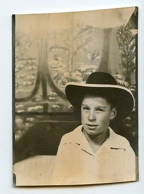 Vintage larger format photobooth photo of adobrable kid wearing cowboy hat moody (Cowboy Photobooth)