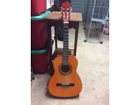 Beautiful 3/4 Spanish Guitar With Carry Case, Capo and Tuner.