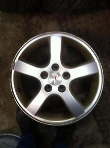 "4 - Used 2005 Montana Van 17"" 5 Bolt (5X115) Alloy Rims with Center Caps"