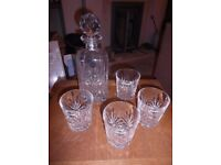 Crystal carafe and four glasses