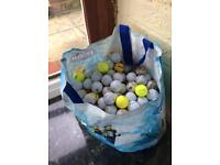 Large bag of used golf balls