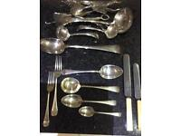 Cutlery service. Traditional antique silver plated with lots of added servers